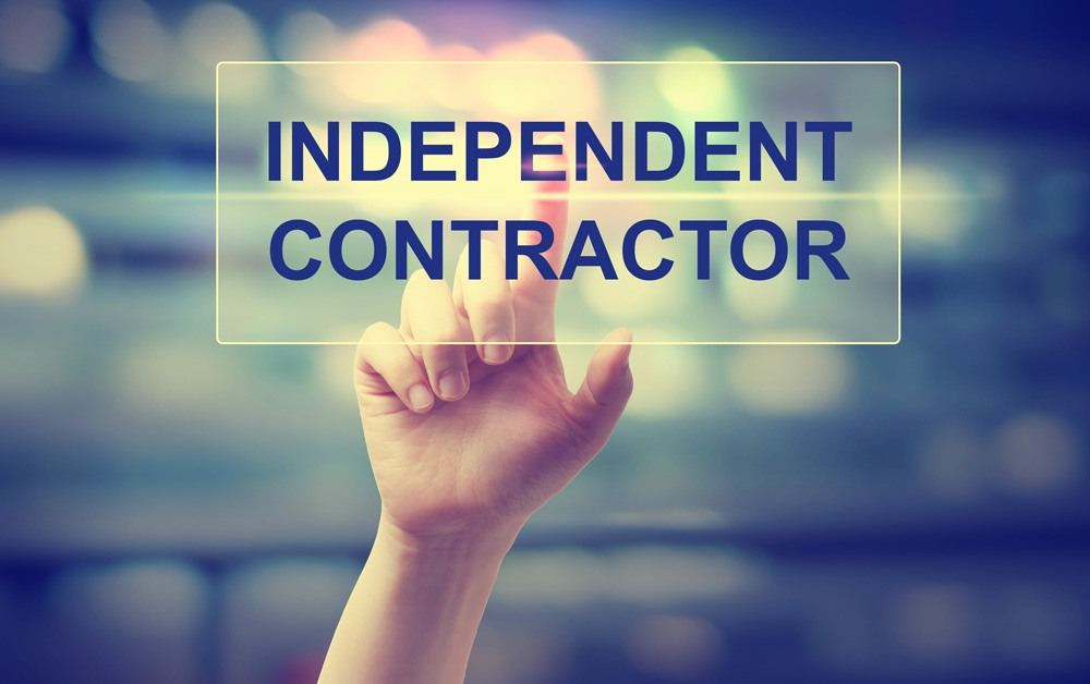 hand reaching for information regarding independent contractors and employment law